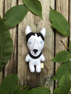 """Felt stuffed dog perfect for a dog lover and ready to be adopted.  Meet Juno. A sweet little lady who loves to sleep in on weekends. Car rides make her the happiest. Considering giving her a freedom ride today.  Approx. 6"""" tall hand cut, hand stitched and hand stuffed 100% wool felt toy.  Custom breeds also available. Now you can commission a felt replica of your own dog.  https://www.etsy.com/listing/253231846/custom-felt-stuffed-dog-gift-for-dog"""