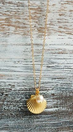 Sea Shell LOCKET Necklace Gold Shell Necklace. Damn I want silver. Or platinum lets be honest.
