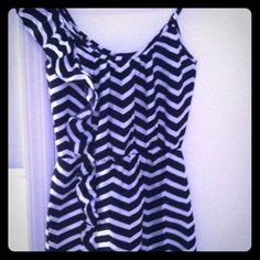 Size smaller black and white sundress. One ruffle shoulder black and white sundress. Size small fits like an extra small. Never worn! Dresses