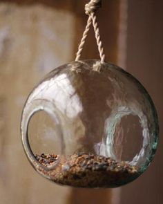 Make some room outside for your feathered friends! Check out our Recycled Glass Bird Feeder.