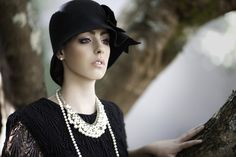 Photograph Zephyre by Hex  on 500px Vintage model Chanel Chic 1920's style hat pearls and black lace dress