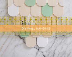 DIY scalloped wood wall hanging.