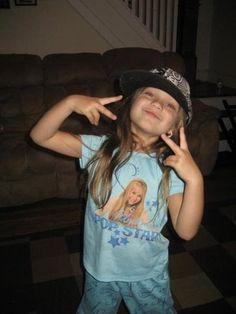 """maddie ziegler wearing an """"undercover pop star"""" hannah montana tee-shirt."""