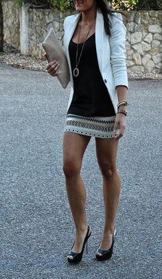 White blazer, pendant necklace, embellished skirt