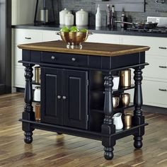 A stylish kitchen island can bring an entire kitchen together, which is especially true with the Home Styles Americana Black Kitchen Island thanks. Black Kitchen Island, Farmhouse Kitchen Island, Kitchen Tops, Kitchen Islands, Kitchen Carts, Kitchen Tables, Movable Island Kitchen, Kitchen Island On Wheels With Seating, Kitchen Signs