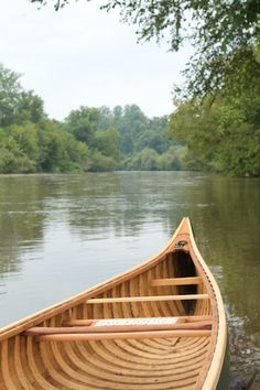 Restored 1940's Old Town canoe on the French Broad River at the Asheville Outdoor Center