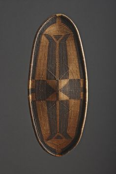 A Central African Democratic Republic of Congo, Western Zande/Bandia Wicker Work Warriors Shield Late 19th Century  Size: 91cm high, 38cm wide – 35¾ ins high, 15 ins wide