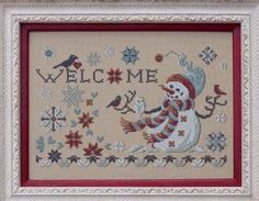 Filigram Welcome Winter - Cross Stitch Pattern. Model stitched on 32 Ct. Light Mocha Belfast linen with Dinky Dye Silks (or DMC 3865, 926, 928, 356, 355, 535, 4