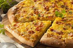 Breakfast Pizza Ingredients:  1 12-inch pre-baked or refrigerated pizza crust (e.g. Pillsbury) 6 eggs 3 tablespoons milk 1/8 teaspoon pepper...
