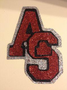 My sons school football logo blinged up using glitter iron on transfer sheets, scal, & my Cricut!