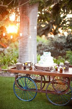 Going crazy over this wheel barrel cake table!