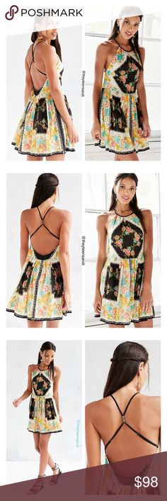 """Urban Outfitters Ecote Bonita Floral Print Dress Intricately patterned high-neck fit + flare dress for dressing up or down, by the modern-boho masters at Ecote from Urban Outfitters. Sleeveless with shirring at the neck + waist, finished with a barely-there back featuring adjustable cross-straps with metal bead accents. Hidden back zip closure. Cotton. Machine wash. Measurements taken from size 6. Chest: 34"""". Length: 34"""". Urban Outfitters Dresses Mini"""