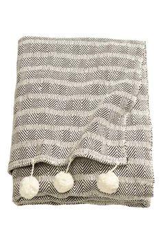 Cubrecama con borlas | H&M