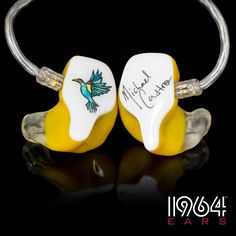 #American #Idol Michael Castro ordered these Custom In-Ear Monitors. Multi-color artwork, yellow shells, white faceplates, soft canals.