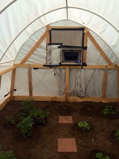 The inside of my greenhouse, with a swamp cooler