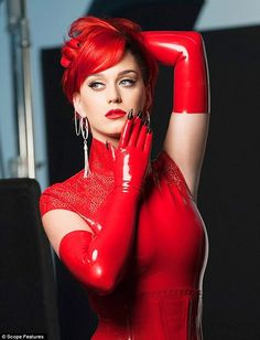 Lady in red: Katy Perry stuns in a new Covergirl shoot to promote her Katy Kat Matte Cri...