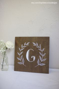 Monogram sign hand painted on stained plywood. Wreath design. Bridesmaid/Groomsmen Gift. Personalized. Wedding. Housewarming. Anniversary
