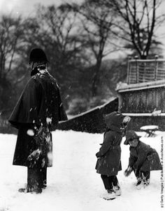 Two children throwing snowballs at a policeman. (Photo by Hulton Archive/Getty Images). Circa 1960