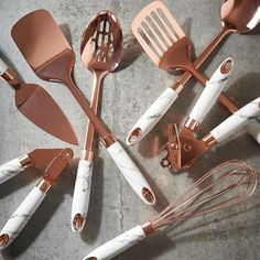 Our favorite pairing - marble and rose gold . Tap the link in bio to find out more . gold kitchen decor Rose Gold Finish and Soft-Touch Marble Utensil Set Rose Gold Marble, Rose Gold Plates, Rose Gold Flatware, Copper And Marble, White Gold, Rose Gold Kitchen Accessories, Rose Gold Decor, Utensil Set, Cooking Utensils