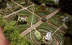 """The DNA Garden in the Garden of Cosmic Speculation in Scotland - this is a 30-acre private garden designed by Charles Jencks with lakes like fractals, a terrace like a black hole and a """"Quark Walk."""" It's open to the public one day a year. This year it's May 6!"""