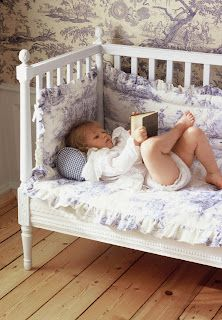 DIY:  This would be a great idea for an old crib!  Remove a side rail, cut down the legs, tie on  bumper pads  & use as a reading nook:) Inspiration.