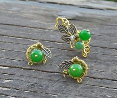 Check out this item in my Etsy shop https://www.etsy.com/listing/232958361/green-ear-cuff-wire-wrapped-ear-cuff