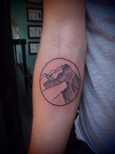 minimalist mountain tattoo