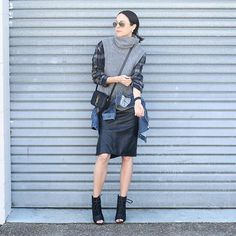 Layered perfection in a plaid shirt, chunky knit turtleneck vest, skirt, and booties.