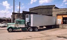 Unloading at Track Side Produce in Milwaukee, Wis. in February 1973 is this classic old Kenworth running for Big Three.