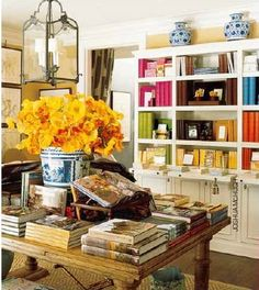 Love the table vase with red flowers?  Such a warm colorful room.