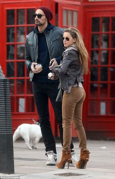 Sweet snack: Hugo and Natalie stopped off at a bakery in Primrose Hill to treat themselves to a cupcake