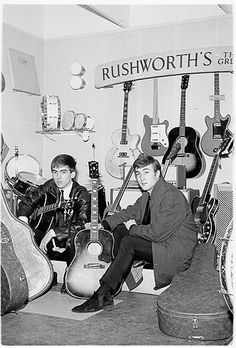 """Harrison with John Lennon in 1962, picking up new guitars at Rushworth's Music House in Liverpool. """"We were just cocky,"""" Harrison said of the Beatles' early days. """"There was no justification for it – [it was] just an inner feeling."""""""