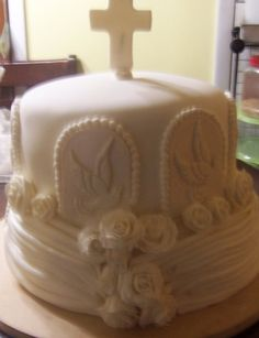 My cousins's first communion and confirmation cake By dreamdelights on CakeCentral.com