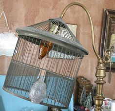 Old birdcage made in to a lampshade at Sisters Garden!