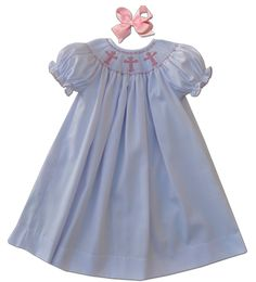 This and That For Kids - Hand Smocked White Crosses Bishop Dress, $39.00 (http://www.thisandthatforkids.com/hand-smocked-white-crosses-bishop-dress/)