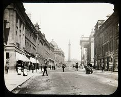 This is a Glass Slide showing Grey Street, Newcastle upon Tyne. The Slide is from some time between the late 19th and early 20th Century. The slide would have been viewed through a Magic Lantern, an early type of image projector.