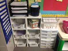 Desk Area: Here is a picture of my desk, where I store my materials. I place all of my materials and papers in these bins. Some of the bins include curriculum pacing guides, work that needs to be...
