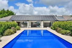in Karaka, NZ. Manuka Lodge locates in Karaka, is a perfect holiday house for those big families' or few friends relaxing holiday or reunion –open spaces, swimming pool, indoor and outdoor kids activities areas, bright and contemporary rooms . Easy access locati...