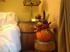 Fall decor with whiskey barrels.
