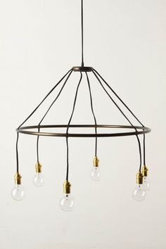 I feel like this could be the easiest lighting fixture to make ever - for over our kitchen table since it's so dang dark. (shell)