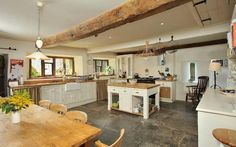 A farm kitchen that is very appealing. Just needs an Aga--and some dried herbs hanging from that big beam--to make it perfect.
