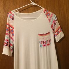 White cute tunic top! Detailed short sleeved arms and pocket! Super cute for summer over a bikini or paired with jeans/ shorts Tops Tunics