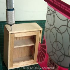Make Glass Front Upper Kitchen Cabinets For the Dollhouse: Drill Holes for Hinge Pins for a Dollhouse Kitchen Cabinet