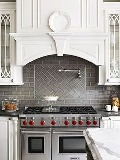 Herringbone Pattern Grey Tile back splash and beautiful cupboard doors                                                                                                                                                                                 More