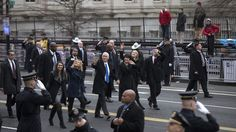 Vice President Mike Pence waves as he and his family walk during the inauguration parade in Washington, Friday, Jan. 20, 2017, past nearly empty bleacher seats next to the Treasury Department.