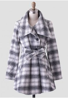 Perfect for when the weather gets cooler, this cute and cozy white wool-blend coat features a black plaid print and an asymmetrical, oversized collar with large front buttons at the placket. Finished with a self-tie sash and welt pockets at the hips, this classic coat looks lovely over your more formal dresses. Fully lined. By BB Dakota.