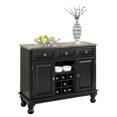 Two-drawer buffet with turned bun feet.  Product: BuffetConstruction Material: Solid and engineered woodCo...