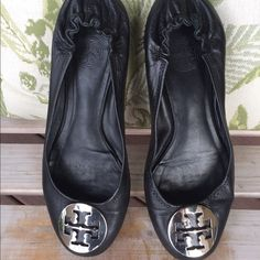 Tory Burch black flats size 8.5.  Tory Burch lightly used black flats w silver medallion size 8.5. There is a small scuff mark on the silver medallion last pics shows that.  Tory Burch Shoes Flats & Loafers