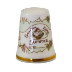 Summer Thimble from the Beautiful adaptation by Royal Dalton of the Brambly Hedge Four seasons Books by Jill Barklam in 1982. This thimble is clean and undamaged stand the floral patterning continues around the thimble and has a green back color with a a dish of ice cream topped with a berry in the center just over 1 inch and would make a great addition to your collection. /$25.95