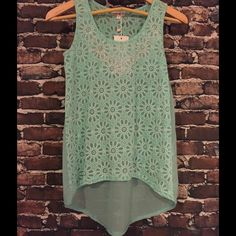 ⚓️Floral High-Low Tank in Mint⚓️ 100% Polyester with rhinestone embellishment on the front. Dry Clean Only. This tank is adorable, pictures don't do it justice! Available in S,M and L. Also available in Mint, Pink and White. Could be used as a bathing suit cover-up or dressed up for a night on the town. Be.You.Tiful Tops Tank Tops